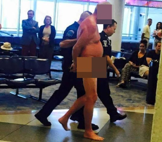 Naked male at th airport