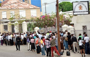 Job seekers line up at the Ministry of Labour and Social Security on East Street in Kingston in search of overseas employment yesterday.